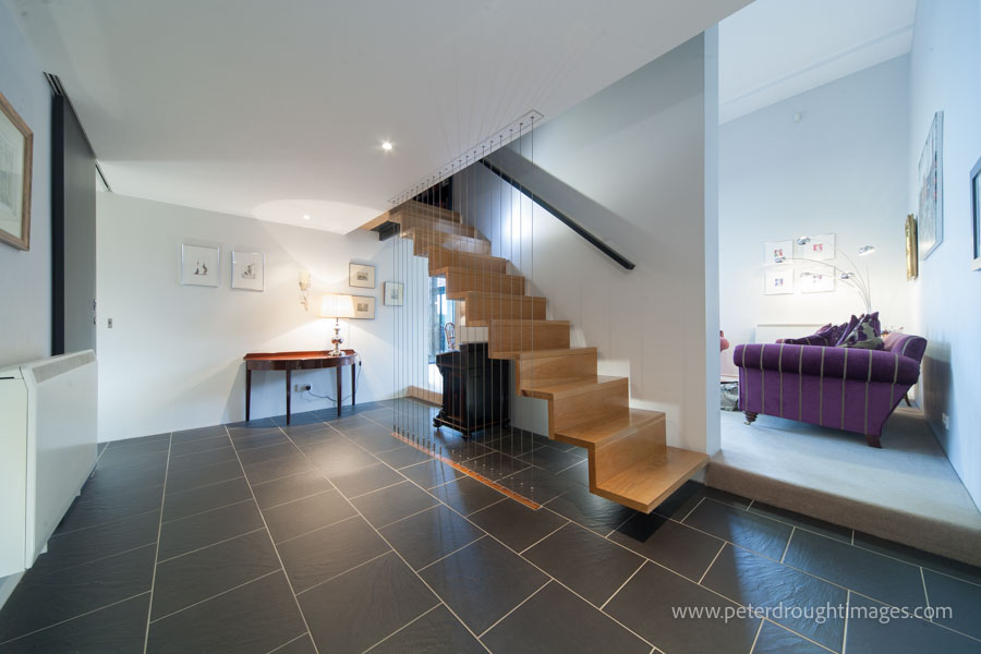 An example of architectural photography being used in practice. A domestic interior with modern staircase.