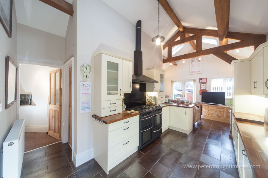 Example of how a property photographer can help. Property photography showing a kitchen with Wooden beams.
